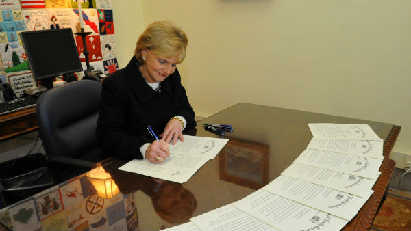 """""""Outgoing Governor Bev Perdue signed a Pardon of Innocence for the Wilmington 10 Monday."""""""