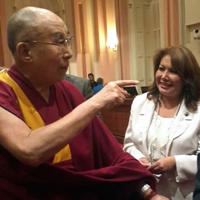 Assemblywoman Patty López with the Dalai Lama in June.